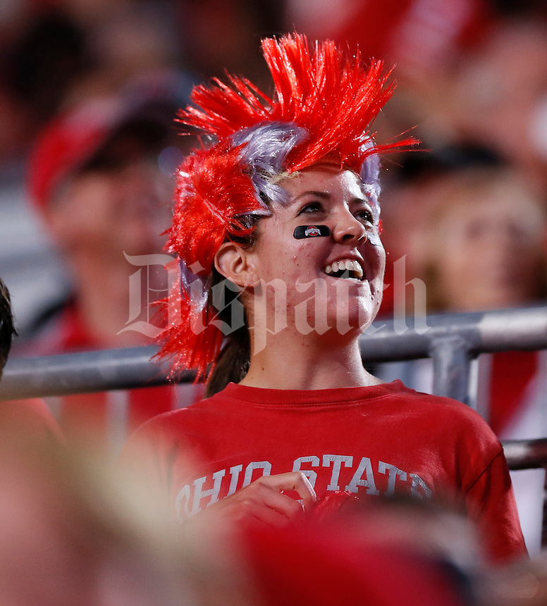 An Ohio State University fan sports a scarlet and grey mohawk during Saturday's NCAA Division I football game at Ohio Stadium in Columbus on September 28, 2013. (Barbara J. Perenic/Columbus Dispatch)