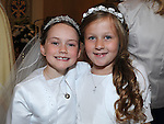 Ashley O'Brien and Fidan Topcu who received First Holy Communion in St. Cianan's church Duleek. Photo: Colin Bell/pressphotos.ie