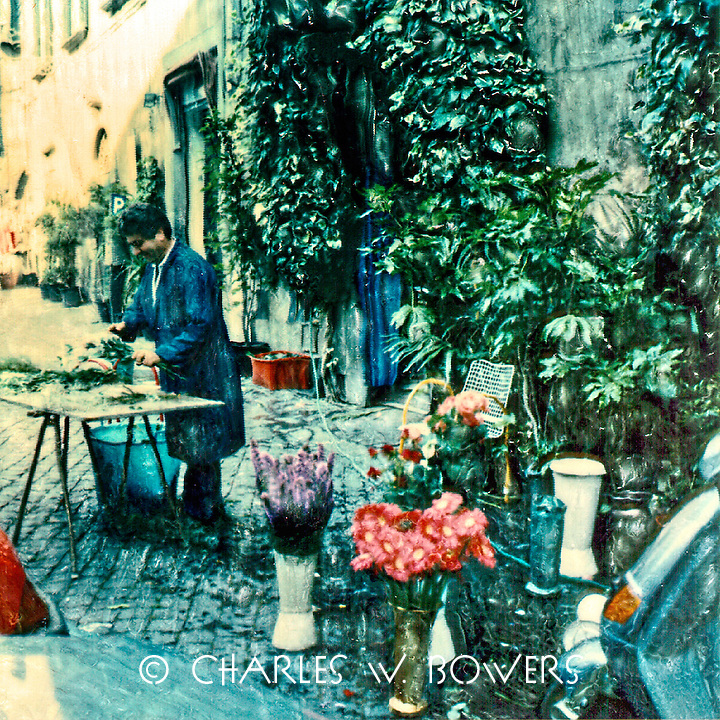 The village florist prepares to bring beauty to your day. Perhaps your friend or lover will bring you some of his bounty today.<br />