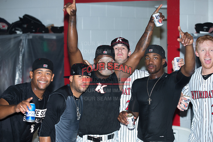 Members of the Kannapolis Intimidators celebrate in the clubhouse after their win against the West Virginia Power at Kannapolis Intimidators Stadium on June 18, 2017 in Kannapolis, North Carolina.  The Intimidators defeated the Power 5-3 to win the South Atlantic League Northern Division first half title.  It is the first trip to the playoffs for the Intimidators since 2009.  (Brian Westerholt/Four Seam Images)