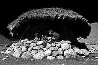 Children playing underneath an Arhuaco hut. Sierra Nevada de Santa Marta, Colombia.