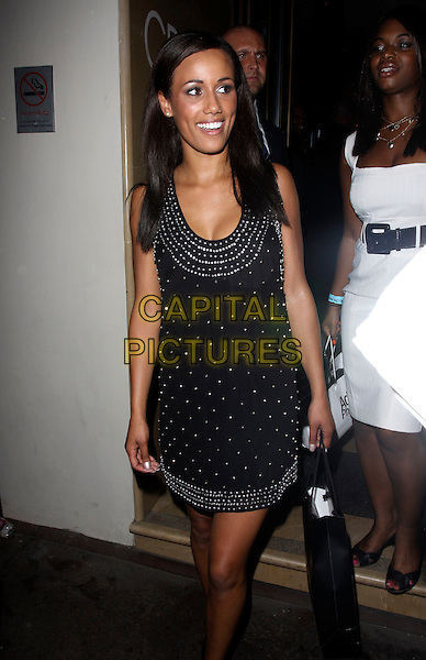 NOIRIN KELLY.Arrives at Nobu Berkeley, London, England..August 26th, 2009.full length black dress studs studded  beads beaded goody bag 3/4 big brother 10.CAP/AH.©Adam Houghton/Capital Pictures.