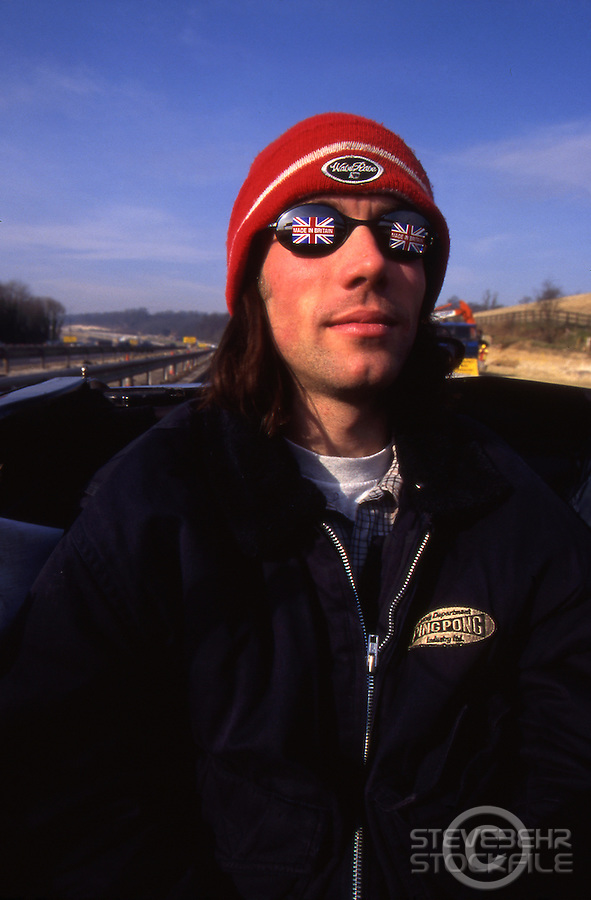 Rob Warner in back seat of Mustang on Motorway .pic copyright Steve Behr / Stockfile