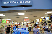 Chinese tourists shopping at duty free shop in Kansai international airport in Japan. .