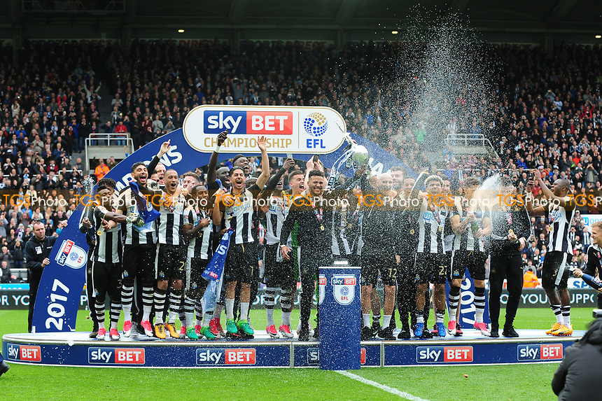 Jamaal Lascelles of Newcastle United lifts the Championship Trophy during Newcastle United vs Barnsley, Sky Bet EFL Championship Football at St. James' Park on 7th May 2017
