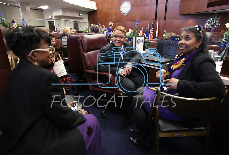 Nevada Sen. Patricia Spearman, D-North Las Vegas, talks with her assistant Pastor Sharlene Myles, left, and her sister Millie Spearman-Royster during the opening day of the 77th Legislative Session in Carson City, Nev. on Monday, Feb. 4, 2013. <br /> Photo by Cathleen Allison