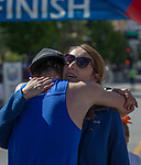 Rob Lugg, the men's marathon winner, gets a hug from girlfriend Jaquelyn Davis after finishing the Downtown River Run on Sunday, April 30, 2017 in Reno, Nevada.