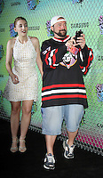 NEW YORK, NY-August 01: Harley Quinn Smith, Kevin Smith at Warner Bros. Pictures & DC, Atlas Entertainment  presents the World Premiere of Suicide Squad  at the Beacon Theatre in New York. NY August 01, 2016. Credit:RW/MediaPunch