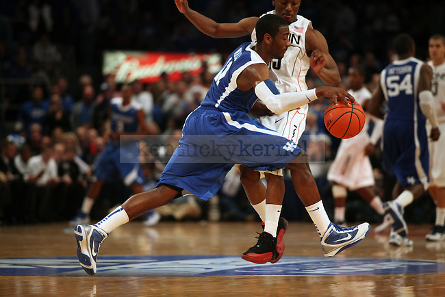 Freshman guard John Wall dribbles the ball down the court in the second half of UK's 64-61 win over UCONN at Madison Square Gardens in New York, NY. Photo by Britney McIntosh | Staff