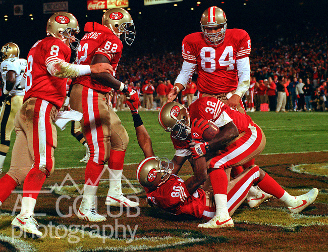 San Francisco 49ers vs. New Orleans Saints at Candlestick Park Monday, November 22, 1993.  49ers beat Saints 42-7.  San Francisco 49ers running back Ricky Watters (32) and wide receiver Jerry Rice celebrate Rice touchdown.
