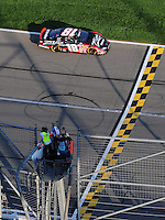 Sept. 27, 2008; Kansas City, KS, USA; NASCAR Nationwide Series driver Denny Hamlin takes the checkered flag to win the Kansas Lottery 300 at Kansas Speedway. Mandatory Credit: Mark J. Rebilas-