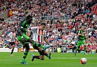 Bafetibis Gomis of Swansea City (left) scores their first goalduring the Barclays Premier League match between Sunderland and Swansea City played at Stadium of Light, Sunderland