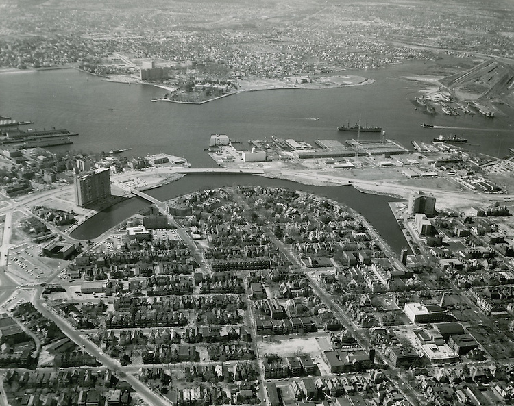 1965 February 19..Redevelopment.Ghent (R-43).Atlantic City (R-1)..Aerial view looking south at Ghent..New apartment tower on left.Brambleton Avenue extension newly complete..HAYCOX PHOTORAMIC INC..NEG# 65-146-8.NRHA# 798-B2..