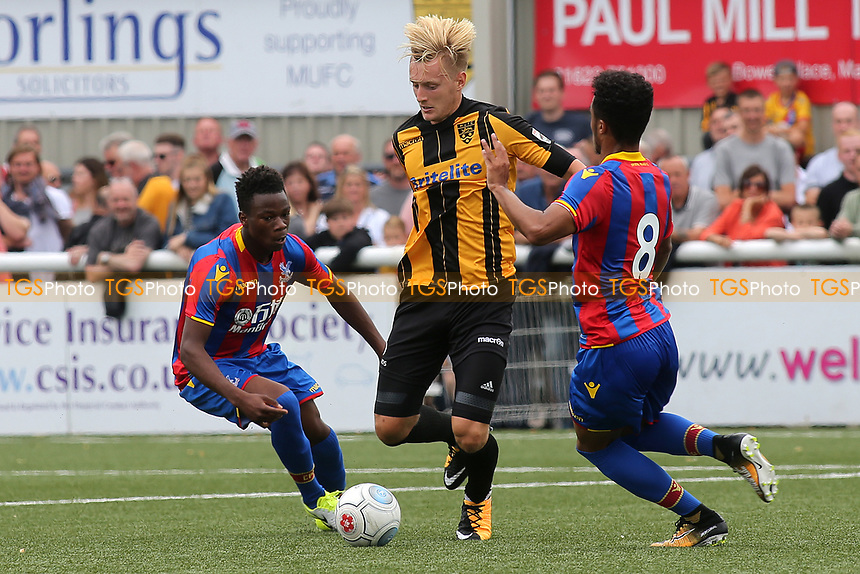 Joe Pigott of Maidstone takes the ball past Kian Flanagan of Crystal Palace during Maidstone United  vs Crystal Palace, Friendly Match Football at the Gallagher Stadium on 15th July 2017