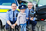 Laura O'Sullivan Murphy showing Gda Eoin Walsh and Gda Niall O'Connor the speed gun provided by An Garda Siochana at the Little Heros Fun day event by Recovery Haven in the John Mitchels Complex on Sunday.
