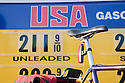 A close up of an USA Gasoline price list and bicycle on March 24, 2009. Los Altos, California, USA