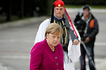 German Chancellor Angela Merkel places a wreath at the monument of the Unknown Soldier during her visit in Athens.