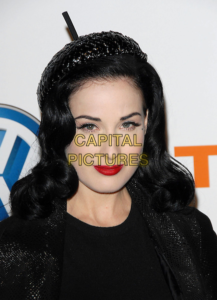 DITA VON TEESE.Attends Volkswagen US Premiere of Concept Tiguan held at Raleigh Studios in Los Angeles, California, USA,.November 28, 2006..portrait headshot red lipstick hairband hairband .CAP/DVS.©Debbie VanStory/Capital Pictures