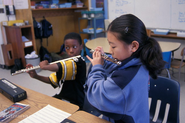 Berkeley CA 4th graders learning to play flutes during music time in class