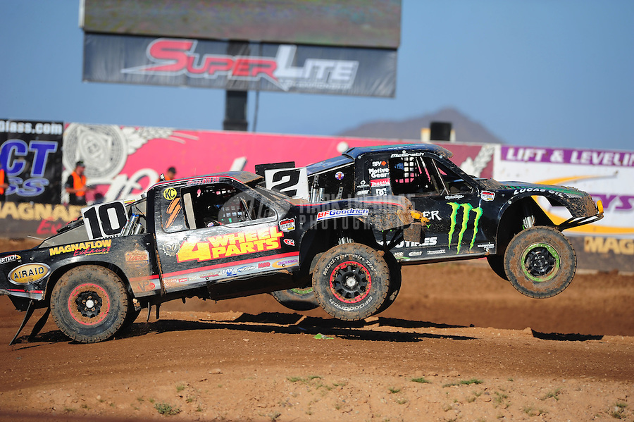 Apr 16, 2011; Surprise, AZ USA; LOORRS driver Jeremy McGrath (2) jumps alongside Greg Adler (10) during round 3 at Speedworld Off Road Park. Mandatory Credit: Mark J. Rebilas-