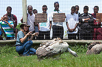 Shannon Hoffman dispelling myths about vultures to students of the Mehlokazulu High School Enviro Club..October 2010..African Bird of Prey Sanctuary..Kwazulu-Natal, South Africa.