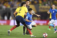 Action photo during the match Brazil vs Ecuador, Corresponding Group -B- America Cup Centenary 2016, at Rose Bowl Stadium<br /> <br /> Foto de accion durante el partido Brasil vs Ecuador, Correspondiante al Grupo -B-  de la Copa America Centenario USA 2016 en el Estadio Rose Bowl, en la foto: (i-d) Arturo Mina de Ecuador y Philippe Coutinho de Brasil<br /> <br /> <br /> 04/06/2016/MEXSPORT/Omar Martinez.