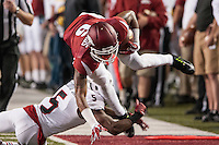 STAFF PHOTO ANTHONY REYES • @NWATONYR<br /> Arkansas' Kendrick Edwards (6) tries to leap from the tackle of Northern Illinois University's Mayomi Olootu (5) in the second half Saturday, Sept. 20, 2014 at Razorback Stadium in Fayetteville. The Razorbacks won 52-14.