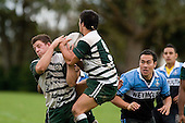 Both M. Knight & J. Davies try to take a the ball from a kick. CMRFU Premier Club Rugby round 4 game between Manurewa & Weymouth played at Manurewa on the 5th of May 2007. Manurewa led 24 - 0 at halftime and went on to win 43 - 7.