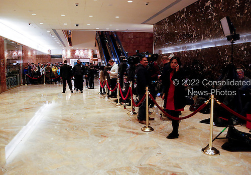 Journalists located behind the rope line on the right and tourists on the left wait to see personalities coming in and out the elevator, in the lobby of the Trump Tower, as United States President-elect Donald Trump is holds meetings on top floors of the building, November 21, 2016, in New York, New York.<br /> Credit: Aude Guerrucci / Pool via CNP