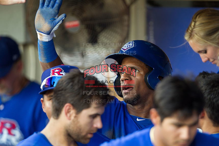 Round Rock Express outfielder Julio Borbon #20 celebrates in the dugout after scoring a first inning run during the Pacific Coast League baseball game against the Oklahoma City RedHawks on June 15, 2012 at the Dell Diamond in Round Rock, Texas. The Express shutout the RedHawks 2-1. (Andrew Woolley/Four Seam Images).