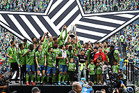 SEATTLE, WA - NOVEMBER 10: Cristian Roldan #7 of the Seattle Sounders FC raises the Philip F. Anschutz trophy while celebrating with his teammates during a game between Toronto FC and Seattle Sounders FC at CenturyLink Field on November 10, 2019 in Seattle, Washington.