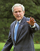 Washington, D.C. - September 12, 2008 -- United States President George W. Bush waves to photographers after arriving on the South Lawn of the White House aboard Marine 1 on Friday, September 12, 2008.  The President is returning from events in Oklahoma City, Oklahoma. <br /> Credit: Ron Sachs / Pool via CNP