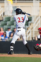 Joel Booker (23) of the Kannapolis Intimidators at bat against the Lakewood BlueClaws at Kannapolis Intimidators Stadium on April 9, 2017 in Kannapolis, North Carolina.  The BlueClaws defeated the Intimidators 7-1.  (Brian Westerholt/Four Seam Images)