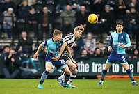 Jonathan Stead of Notts Co battles Dominic Gape of Wycombe Wanderers during the Sky Bet League 2 match between Notts County and Wycombe Wanderers at Meadow Lane, Nottingham, England on 10 December 2016. Photo by Andy Rowland.