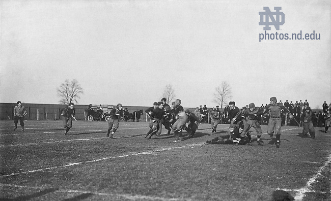 """GATH 19/01:  Football Game Scene - ND vs. Wabash, 1909/1120.  Offensive play including Harry (Red) Miller, William Schmitt, Joe Collins, George Philbrook, Al (Red) Kelly, Luke Kelly, Don Hamilton, Sam """"Rosey"""" Dolan, Howard (Cap) Edwards, Ed Lynch..Image from the University of Notre Dame Archives."""