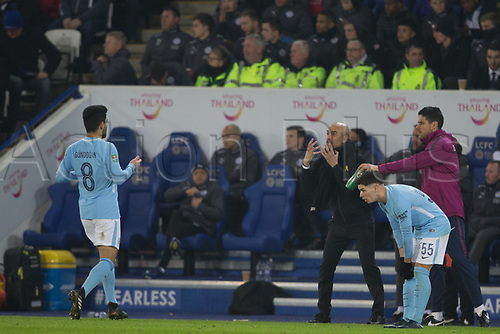 19th December 2017, King Power Stadium, Leicester, England; Carabao Cup quarter-final, Leicester City versus Manchester City; Pep Guardiola manager of Manchester City furiously gives out orders to Ilkay Gundogan of Manchester City