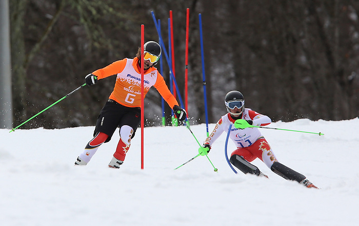 13/03/2014. Canadian Mac Marcoux and his guide Robin Femy compete in the men's  slalom visually impaired event at the Sochi 2014 Paralympic Winter Games in Sochi Russia. (Photo Scott Grant/Canadian Paralympic Committee)
