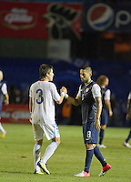 Guatemala's (3) Elias Vasquez shakes hands with the USA's Clint Dempsey (8) at the end of the game.  The United States played Guatemala at Estadio Mateo Flores in Guatemala City, Guatemala in a World Cup Qualifier on Tue. June 12, 2012.