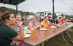 Participants in the pawpaw eating contest prepare for the contest during the Pawpaw Festival on Sept. 17, 2016.