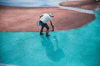 NEW YORK, NY - MAY 27: View of artist Jorge Rodríguez painting on May 27, 2020 in Queens, New York. The artist Jorge Rodríguez Gerada makes a stunning mural in Flushing Meadows, Corona Park to Dr. Ydelfonso Decoo, an immigrant doctor who died of complications from Coronavirus. The mural is also made in gratitude to the millions of medical workers who have given their lives to fight COVID-19. (Photo by Pablo Monsalve / VIEWpress via Getty Images)