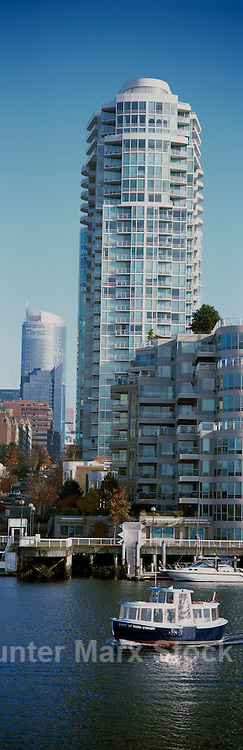 Vancouver, BC, British Columbia, Canada - Aquabus Ferry crossing False Creek past High Rise Apartment Condominium Building in Yaletown - Panoramic View