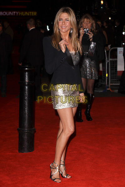JENNIFER ANISTON .Attending 'The Bounty Hunter' UK film premiere at the Vue West End,cinema Leicester Square, London, England, UK. March 11th, 2010 .arrivals full length black jacket blazer silver metallic shiny dress strappy sandals grey gray open toe tuxedo tux beaded hand side.CAP/AH.©Adam Houghton/Capital Pictures.