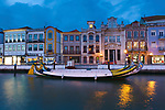 Moliceiro boats docked and Art Nouveau style buildings, Aveiro, Portugal