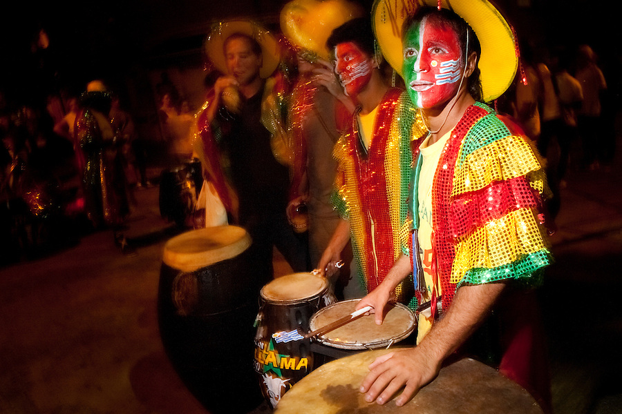 Drummers prepare to enter the parade of Llamadas during Carnaval in Montevideo, Uruguay.