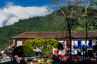 Brightly painted colonial houses are seen on the main plaza in Jardín, a village in the coffee region (Zona cafetera) of Colombia, 30 November 2016.