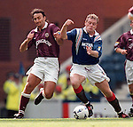 Paul Gascoigne elbows his way past Hearts player Stefano Salvatore