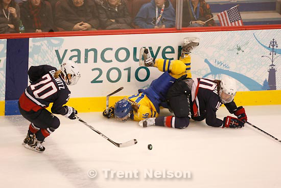 Trent Nelson  |  The Salt Lake Tribune.Sweden's Pernilla Winberg flips over USA's Meghan Duggan. USA's Natalie Darwitz at left. USA vs. Sweden, women's hockey, at the XXI Olympic Winter Games in Vancouver, Monday, February 22, 2010.