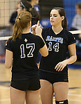 Marymount's Becca Schroeder and Erin Allison get ready for a college volleyball game, in Arlington, Vir., on Saturday, Nov. 1, 2014.<br /> Photo by Cathleen Allison