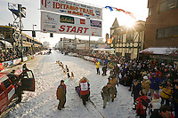 Mitch Seavey leaves the start line @ 2006 Iditarod Ceremonial Start Downtown Anchorage Alaska Winter