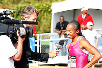 Natasha Hastings being interviewed by Dwight Stones after her 400m victory at the Adidas Track Classic 2009 on Saturday, May 16, 2009 at the Home Depot Center, Carson, Ca. Photo by Errol Anderson,The Sporting Image.net